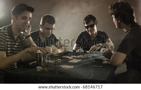 4 guys playing poker - stock photo