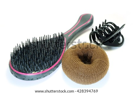 Hair brush , hairpin and Donut bun maker isolated on white background. - stock photo