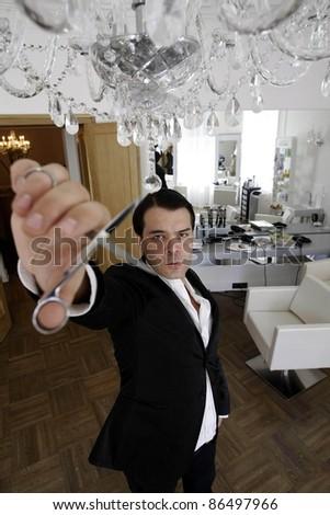 hairdresser posing in salon - stock photo
