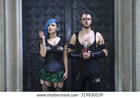 halloween a horrorpunk style couple in a graveyard - stock photo