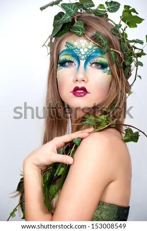Halloween. Beautiful Creative Fashion Make up. Dryad. Mermaid  - stock photo