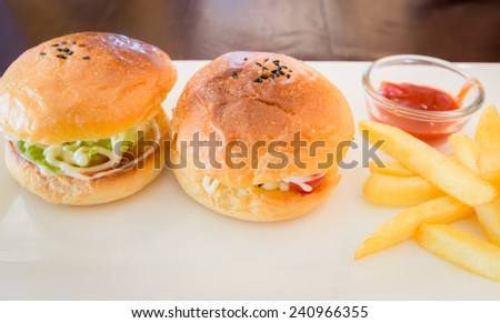 2 hamburger with fresh vegetables and French Fries