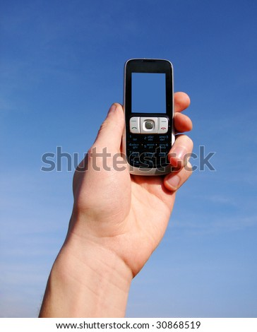 hand holding a mobile phone for support