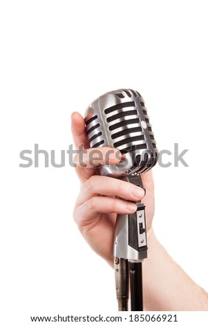 hand holding a retro microphone, isolated on white - stock photo