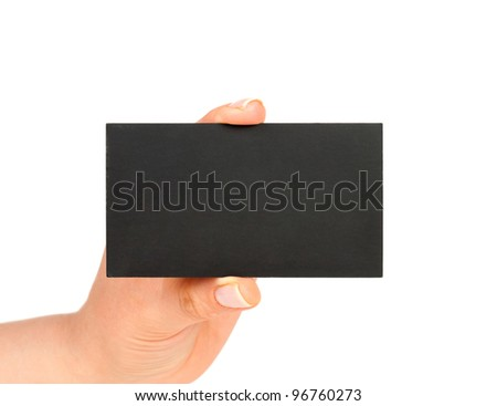 hand holding blank black paper business card, closeup isolated on white background - stock photo