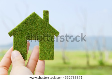 hand holding eco house icon concept