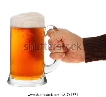 hand holding glass of beer isolated on a white background. - stock photo