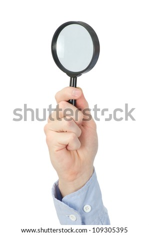 hand holding magnifying glass - stock photo