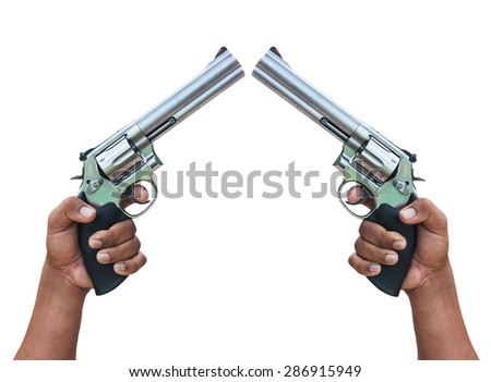 hand holding  revolvers on isolate background - stock photo