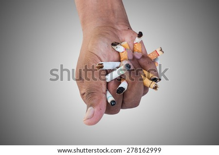 Hand Man Crushing Cigarettes Concept No Smoking on gray background