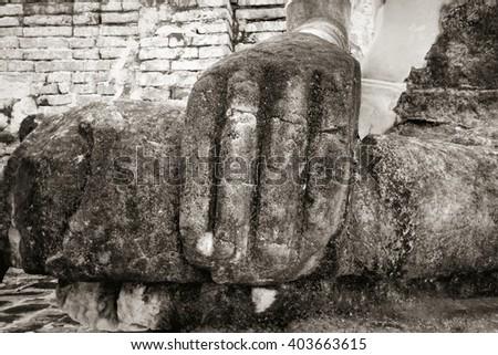 Hand of  ancient Buddha image at  Ayuthaya, Thailand (black and white) - stock photo