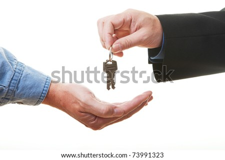 Hand of businessman passing a set of keys to another hand. Clipping path isolated on white. - stock photo