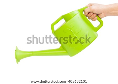 Hand on holding a big green watering can isolated on white background - stock photo