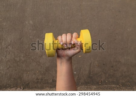 hand takes a heavy dumbbell - stock photo