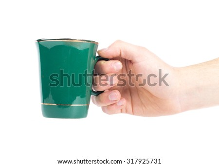 hand with green teacup isolated on a white background.