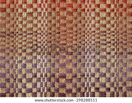 Hand-woven fabric with geometrical pattern - stock photo