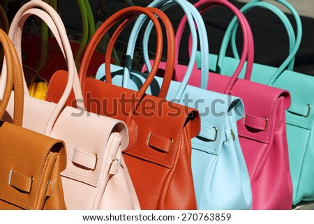 handbags collection on San Lorenzo market in Florence, Italy, Europe - stock photo