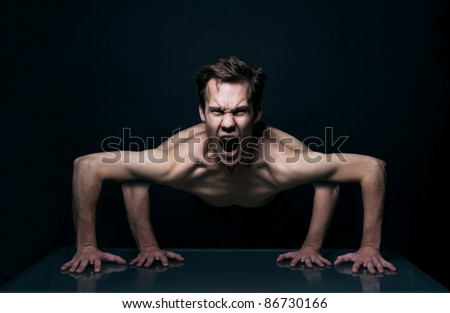 4-handed, mutated human body screaming - stock photo