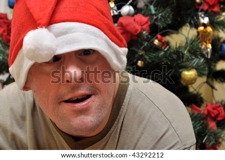 Handicapped man with santa hat - stock photo