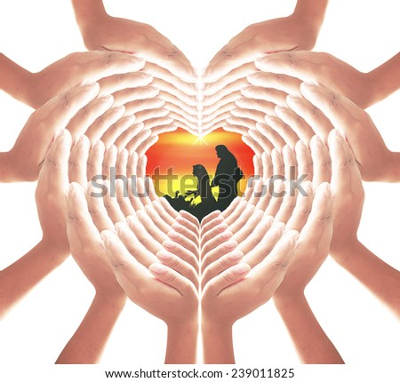 84 hands for heart and web shape with silhouette Mary, Joseph and Jesus in the manger in Bethlehem on Christmas Eve, web of love from God. - stock photo