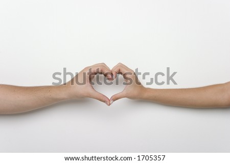 hands forming a heart shape against a white background