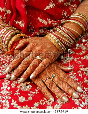 hands of an indian bride decorated with henna - stock photo