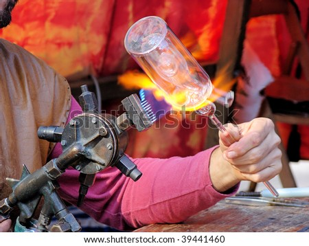hands of the handicraftsman making a glass subject at fair of crafts in Barcelona, Spain