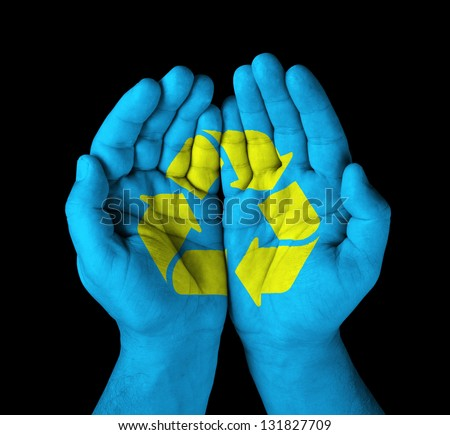 hands with painted recycle symbol - stock photo