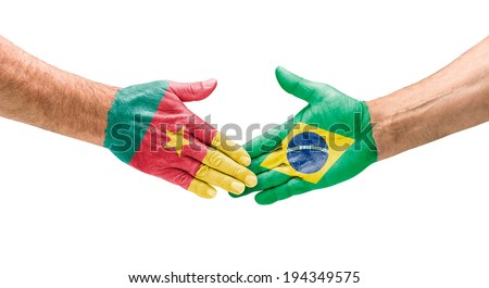 Handshake Cameroon and Brazil - stock photo