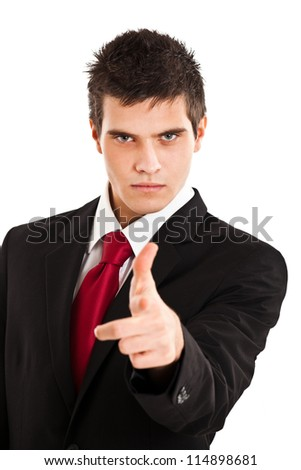 Handsome businessman pointing his finger at you - stock photo