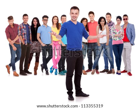 handsome man welcoming to a young casual group of people - stock photo