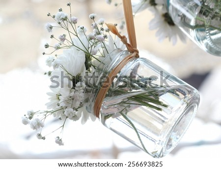hang flower clear glass vase - stock photo