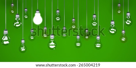 Hanging light bulbs with glowing one isolated on green background - stock photo