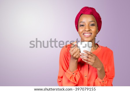 happy african american woman drinking tea from cup or mug  - stock photo