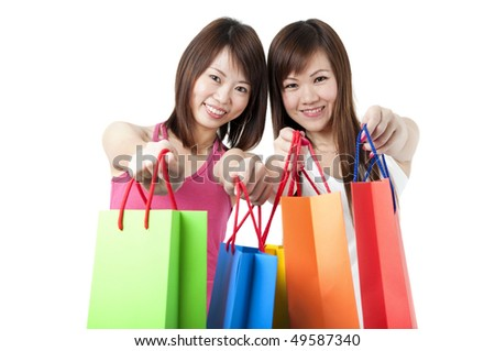 2 happy asian girl shopping with isolated white background - stock photo