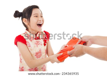 happy asian little girl received red envelope for  chinese new year - stock photo