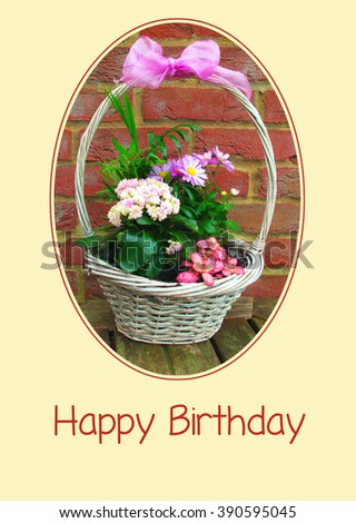 Happy Birthday card with a basket of flowers                              - stock photo