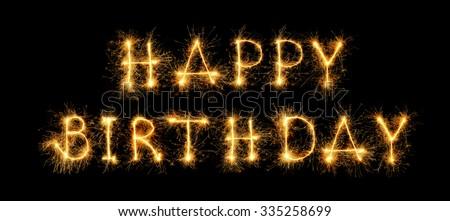 """happy birthday"" message from sparkler - stock photo"