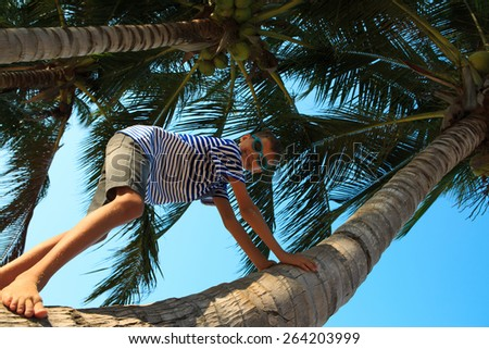 Happy boy is playing and laughing on the beach - stock photo
