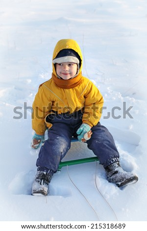 happy boy  on sled - stock photo