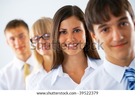 Happy business woman with her colleagues standing in a row. - stock photo