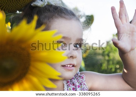 Happy Child on the field with sunflowers