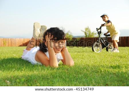 Happy children on beautiful green meadow - stock photo