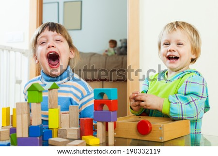 happy children playing with blocks  in home  - stock photo