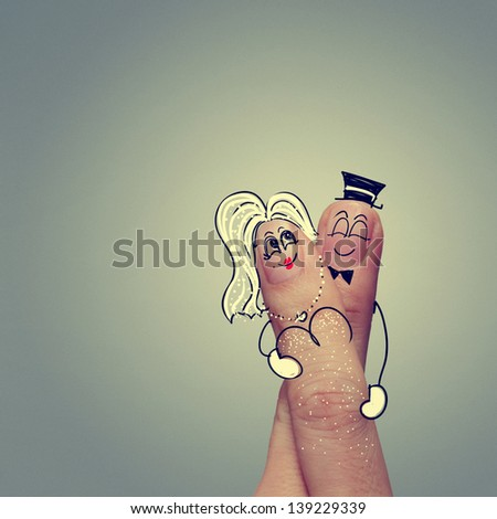 happy couple in love with painted smiley and hugging - stock photo