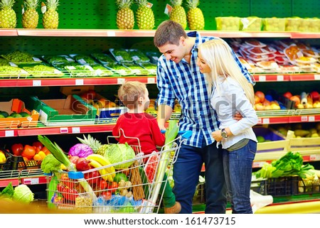 happy family buying food in supermarket - stock photo