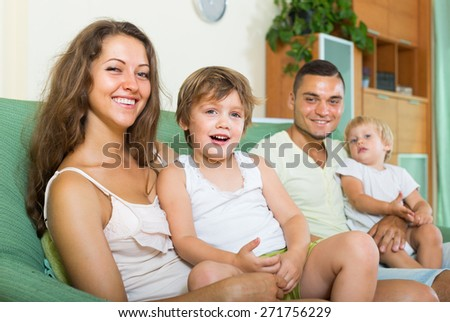 happy family of four  at their home - stock photo