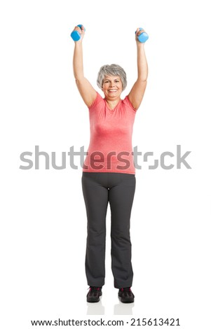 Happy fitness old woman lifting dumbbells and smiling