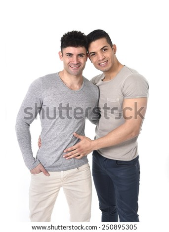 happy gay homosexual couple of young attractive and handsome good looking men in love having big strong bodies posing and smiling isolated on white background - stock photo