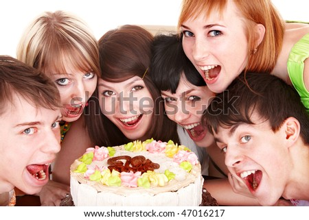 Happy group of young people with cake. Isolated. - stock photo
